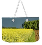Rapeseed Field With Storm Clouds In Background Weekender Tote Bag