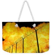 Realistic Orange Fire Explosion Behind Restricted Area Barbed Wire Fence, Blurred Background Weekender Tote Bag