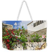 Red Flowers On A Wall Weekender Tote Bag