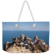 Red Rocks On Blue Sky And Water Background Weekender Tote Bag by Sergey Taran