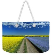 Road Through Flowering Flax And Canola Weekender Tote Bag