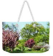 Row Of Flowering Trees Weekender Tote Bag