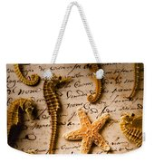 Seahorses And Starfish On Old Letter Weekender Tote Bag by Garry Gay