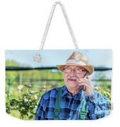 Senior Gardener Talking On The Phone With A Client. Weekender Tote Bag