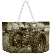 Sepia Toned Old Farmall Tractor In A Grassy Field Weekender Tote Bag