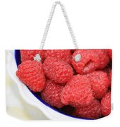 Side View Of Rasberries In Blue Bowl Weekender Tote Bag