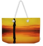 Silhouette Of A Girl Practicing Yoga Reflected On The Surface Of Water During Beautiful Sunset Weekender Tote Bag