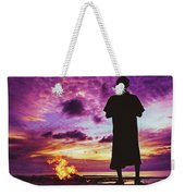 Silhouette Of A Local Man Standing By The Bonfire On The Beach In Maldives During Dramatic Sunset Weekender Tote Bag