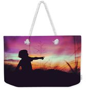 Silhouette Of A Playful Boy Pointing With Finger In The Field During Beautiful Sunset Weekender Tote Bag