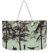 Silhouette Of A Young Men With Crossed Hands Above His Head Camping Hammocking In The Nature Weekender Tote Bag