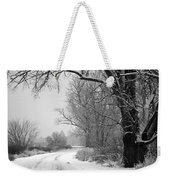 Snowy Branch Over Country Road - Black And White Weekender Tote Bag by Carol Groenen