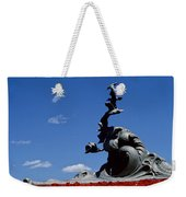 Statue And Tulips Against A Clear Blue Weekender Tote Bag