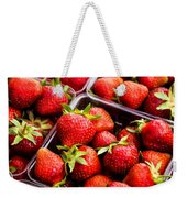 Strawberries With Green Weed In Plastic Containers  Weekender Tote Bag