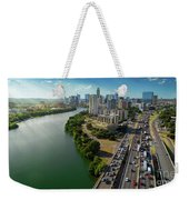 Sunrays Paint The Austin Skyline As Rush Hour Traffic Picks Up On I-35 Weekender Tote Bag