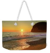 the beach and the Mediterranean sea in Montenegro in the summer at sunset Weekender Tote Bag