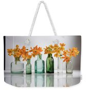 the Blooming yellow Ornithogalum Dubium in a transparent bottle instead vase Weekender Tote Bag