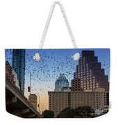 The Frost Bank Tower Stands Guard As 1.5 Million Mexican Free-tail Bats Overtake The Austin Skyline As They Exit The Congress Avenue Bridge Weekender Tote Bag