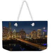 The Glimmering Neon Lights Of The Downtown Austin Skyscrapers Illuminate The Skyline Over Lady Bird Lake Weekender Tote Bag
