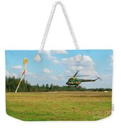 The Helicopter Over A Green Airfield. Weekender Tote Bag