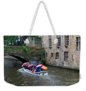 Tourists With Umbrellas In A Sightseeing Boat On The Canal In Bruges Weekender Tote Bag