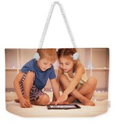Two Happy Children Playing On The Tablet Weekender Tote Bag