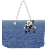 Two Sa-330 Puma Helicopters Deliver Weekender Tote Bag by Stocktrek Images