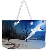 Two Seagulls Fly Together In The Clear Blue Sky Weekender Tote Bag by Fernando Cruz