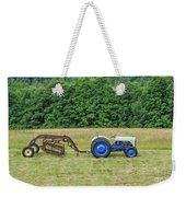 Vintage Ford Blue And White Tractor On A Farm Weekender Tote Bag