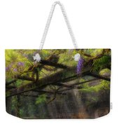 Wisteria Flowers Blooming On Trellis Over Water Fountain Weekender Tote Bag