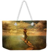 Woman Crossing The Sea On Stepping Stones Weekender Tote Bag by Jill Battaglia