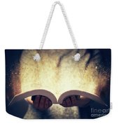 Woman Holding An Open Book Bursting With Light. Weekender Tote Bag