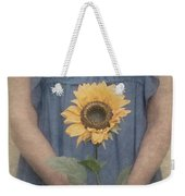 Woman In Blue Dress Holding Sunflower Weekender Tote Bag by Clayton Bastiani