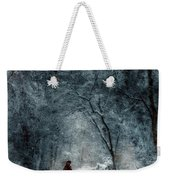Woman In Red Cape Walking In Snowy Woods Weekender Tote Bag