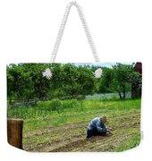 Woman Planting Garden Near Barn Weekender Tote Bag