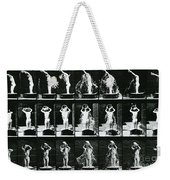 Woman Pouring A Basin Of Water Over Her Head Weekender Tote Bag