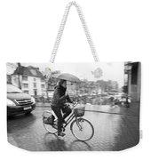 Woman Riding In The Raing Weekender Tote Bag