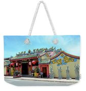 Woman Sits Outside Chinese Temple With Urn And Deity Statues Pattani Thailand Weekender Tote Bag