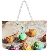 Woman's Hand Coating A Donut With Green Frosting. Weekender Tote Bag