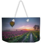 Yellow Hot Air Balloon Over Tulip Field In The Morning Tranquili Weekender Tote Bag