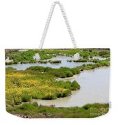 Yellow Wildflowers At Mud Volcano Area In Yellowstone National Park Weekender Tote Bag