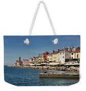 Young Couple Fishing Reading Sunbathing On Dock At Piran Sloveni Weekender Tote Bag