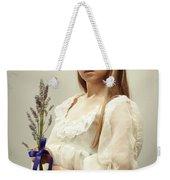 Young Girl Holding Lavender Weekender Tote Bag