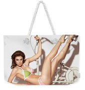 Young Woman In A Swimsuit Posing With Exercise Bike Weekender Tote Bag