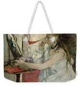Young Woman Powdering Her Face Weekender Tote Bag