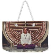 Young Woman Sitting And Meditating In A Lotus Position In Front Of A Unique Doors Weekender Tote Bag