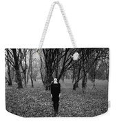 Young Woman With Her Head Tilted Back While Standing In A Forest Weekender Tote Bag