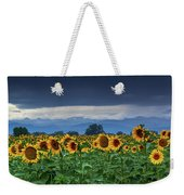 Sunflowers Under A Stormy Sky Weekender Tote Bag by John De Bord