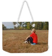A Woman Is  Sitting In A Park And Admiring The Landscape Weekender Tote Bag