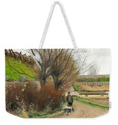 Autumn Weather. A Man With A Wheelbarrow On A Path Weekender Tote Bag