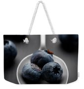 blueberries and a silver spoon on distressed wood No. 2 Weekender Tote Bag